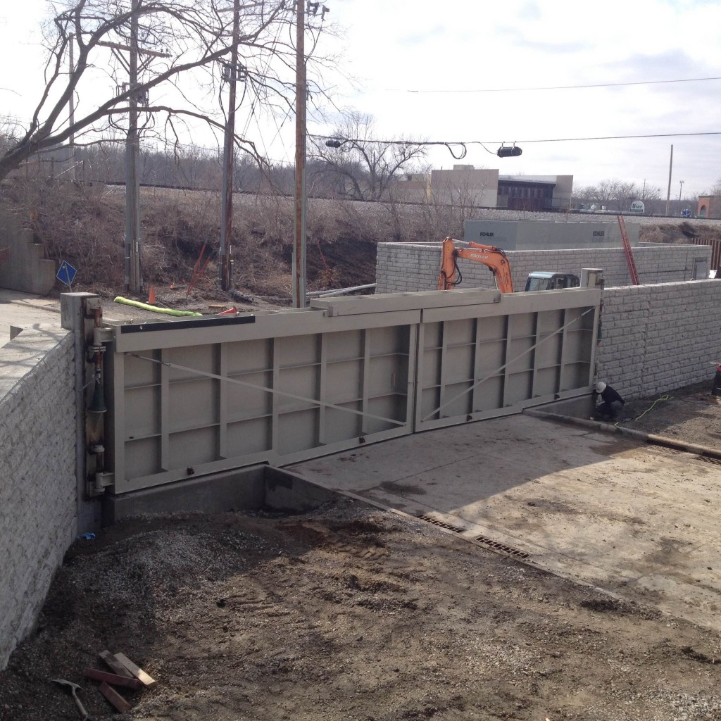 Preliminary Testing of Large Double Hinged Flood Barrier